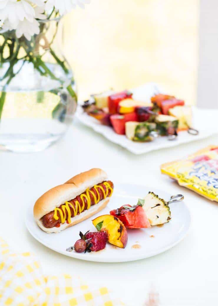 Grilled Fruit Kabobs with a Cinnamon Honey Glaze... an easy side dish to grilled hotdogs. A perfect summertime dinner!