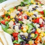 mexican salad with chipotle dressing drizzled on top