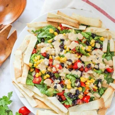 mexican salad on a plate with tortilla strips