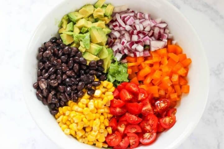 ingredients for mexican salad in a large bowl