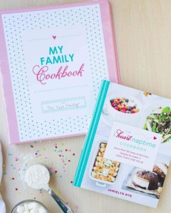 A family recipe binder and The I Heart Naptime Cookbook sitting on the counter