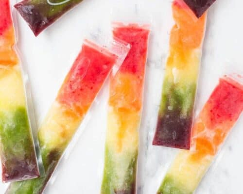 homemade rainbow popsicles on the counter
