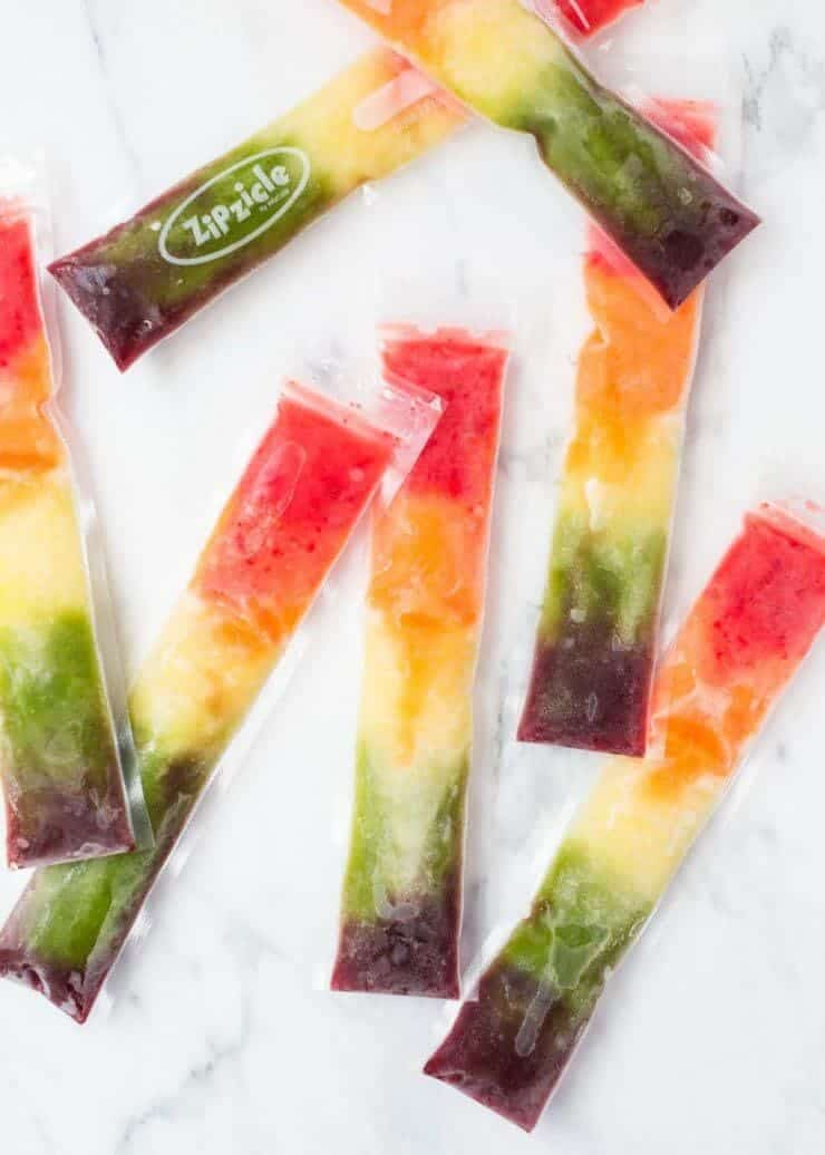 EASY homemade rainbow popsicles made with 100% fruit! The perfect treat for an after school snack to cool off.
