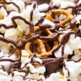 close up of s'mores snack mix drizzled with chocolate