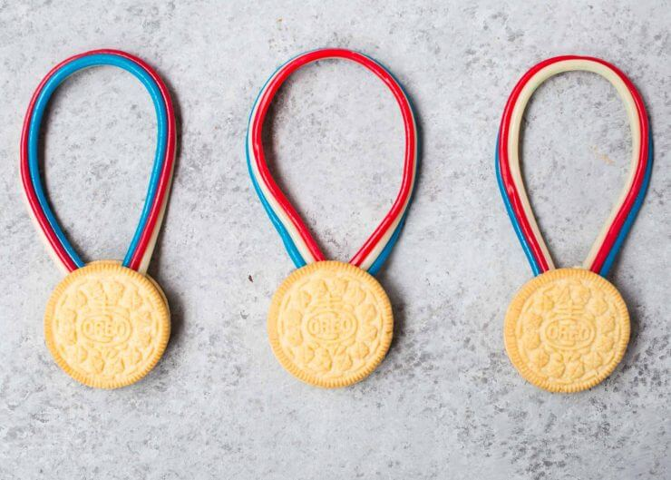 Olympic Snack Ideas... easy to make gold metals using OREO cookies and twizzlers!