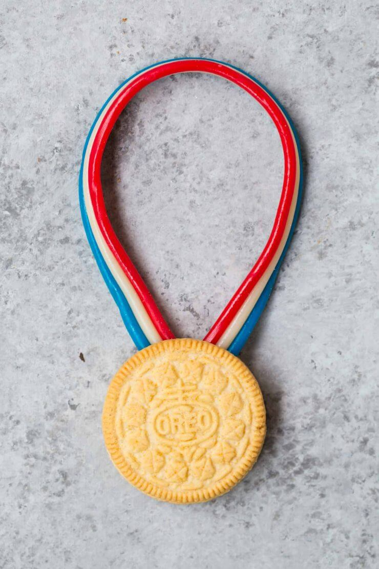 LOVE these Olympic Snack Ideas... these delicious gold metals made out of OREO'S and twizlers are so fun!