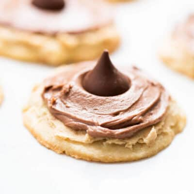 Double Frosted Peanut Butter Blossoms...peanut butter blossoms topped with two layers of frosting (peanut butter and chocolate) and topped with a delicious HERSHEY'S KISSES chocolate!