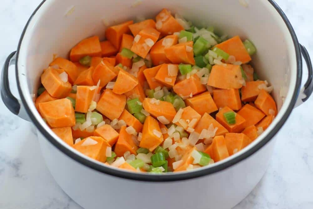 chopped sweet potatoes, onion and celery in a large pot