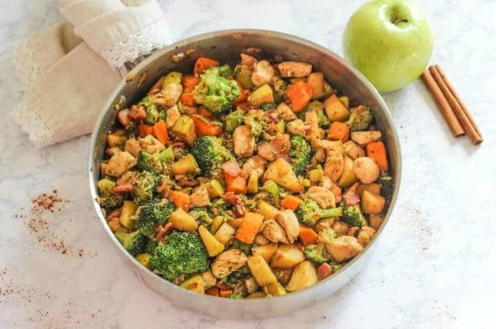 chicken, veggies and apples in a pan