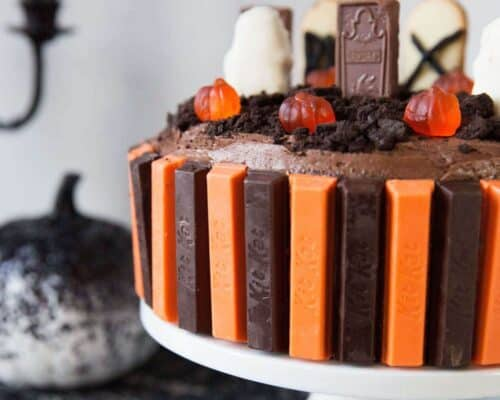 Halloween Graveyard Cake... serve up this spooky chocolate graveyard cake for your next Halloween party! It's super easy and delicious!