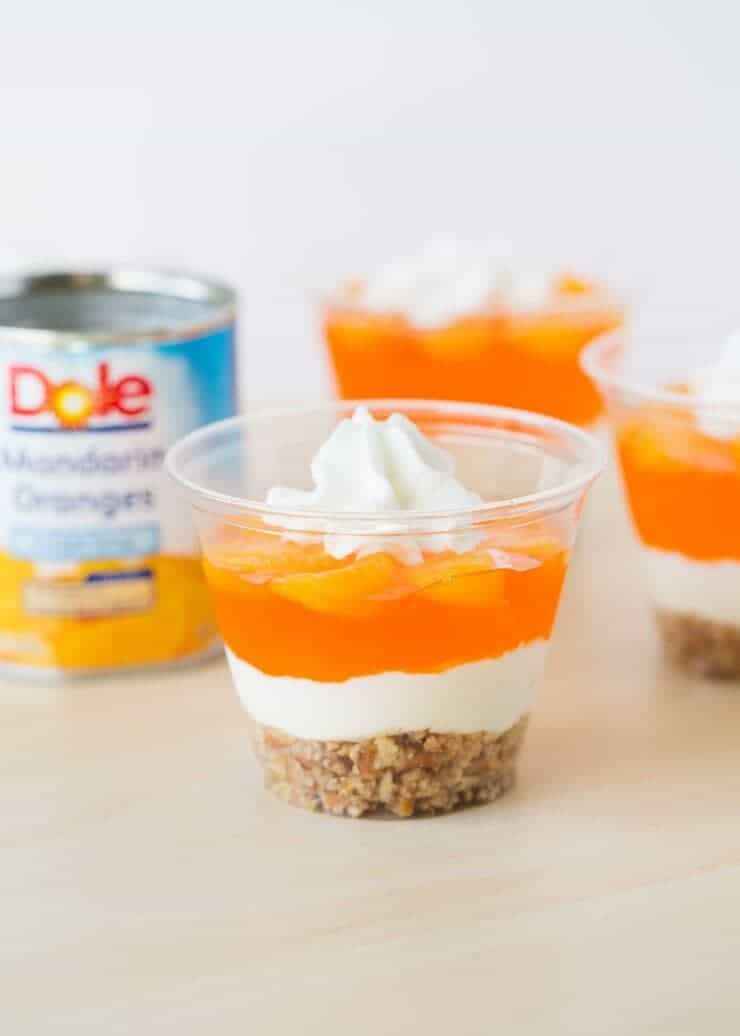 Easy no-bake mandarin orange pretzel parfaits made with Dole mandarin oranges a pretzel crust and cream cheese filling -YUM!