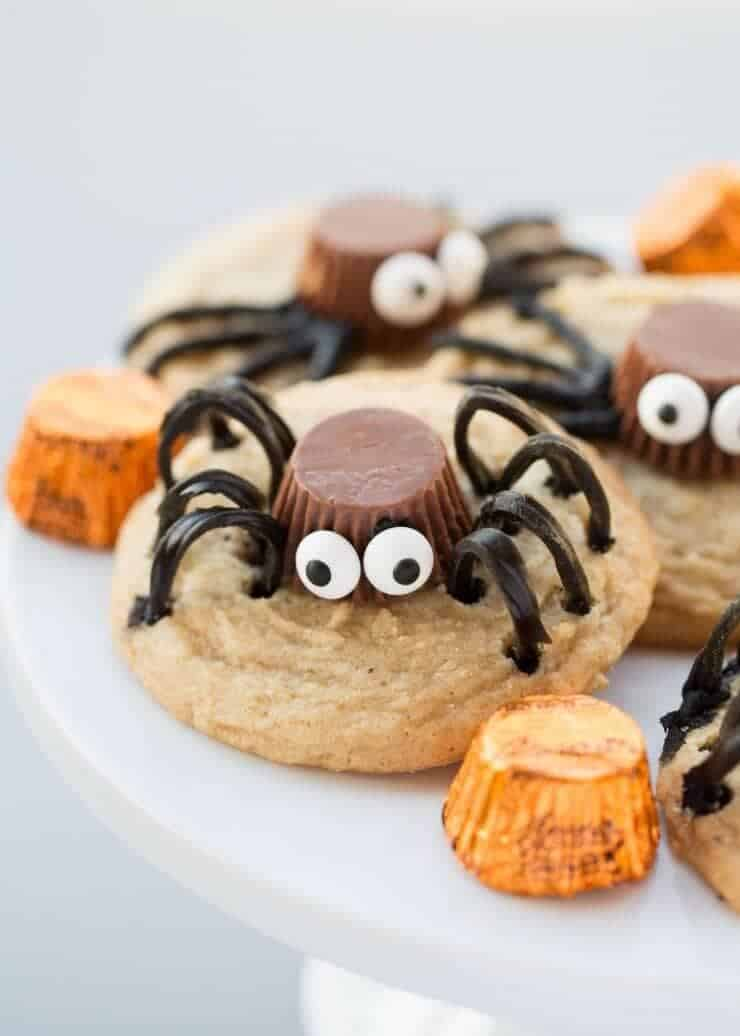 Spider Cookies made with a REESE'S Peanut Butter Cups Miniatures, candy eyes and TWIZZLERS Twists. These are the perfect Halloween cookie for kids and adults!