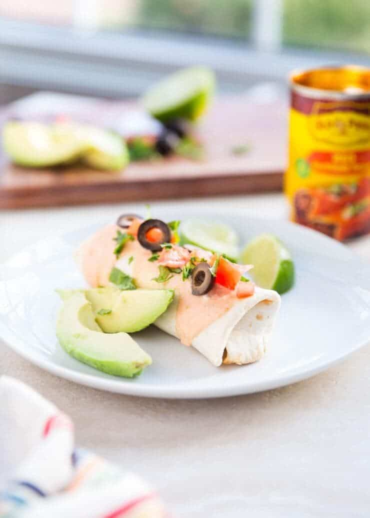 Baked Chicken Burritos... an easy and delicious meal to make in less than 30 minutes. I love to top my burrito with tomatoes, avocado or guacamole, cilantro and olives. YUM!