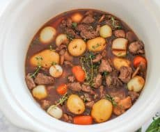 Slow Cooker Beef Bourguignon ...an easy and hearty holiday meal made with beef, burgundy wine, fresh vegetables and herbs. The alcohol is cooked out, leaving a rich and thick liquid for the beef and vegetables to cook in.