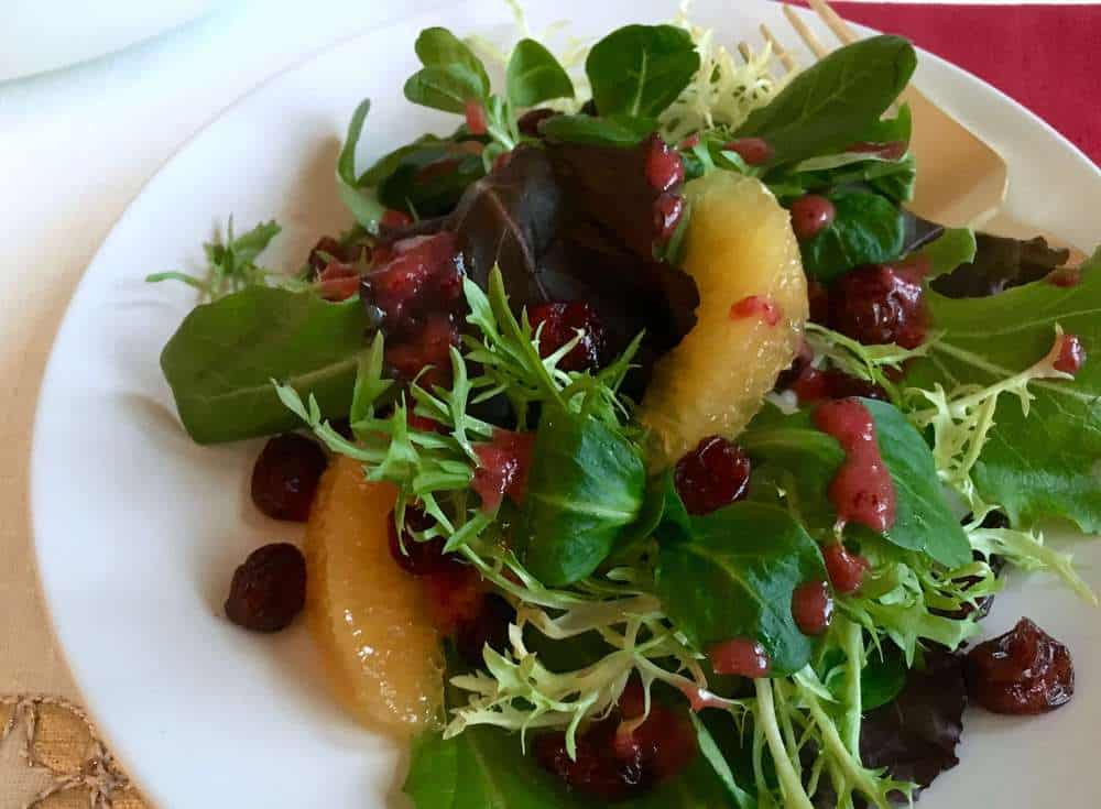 close up of winter salad with cranberry vinaigrette