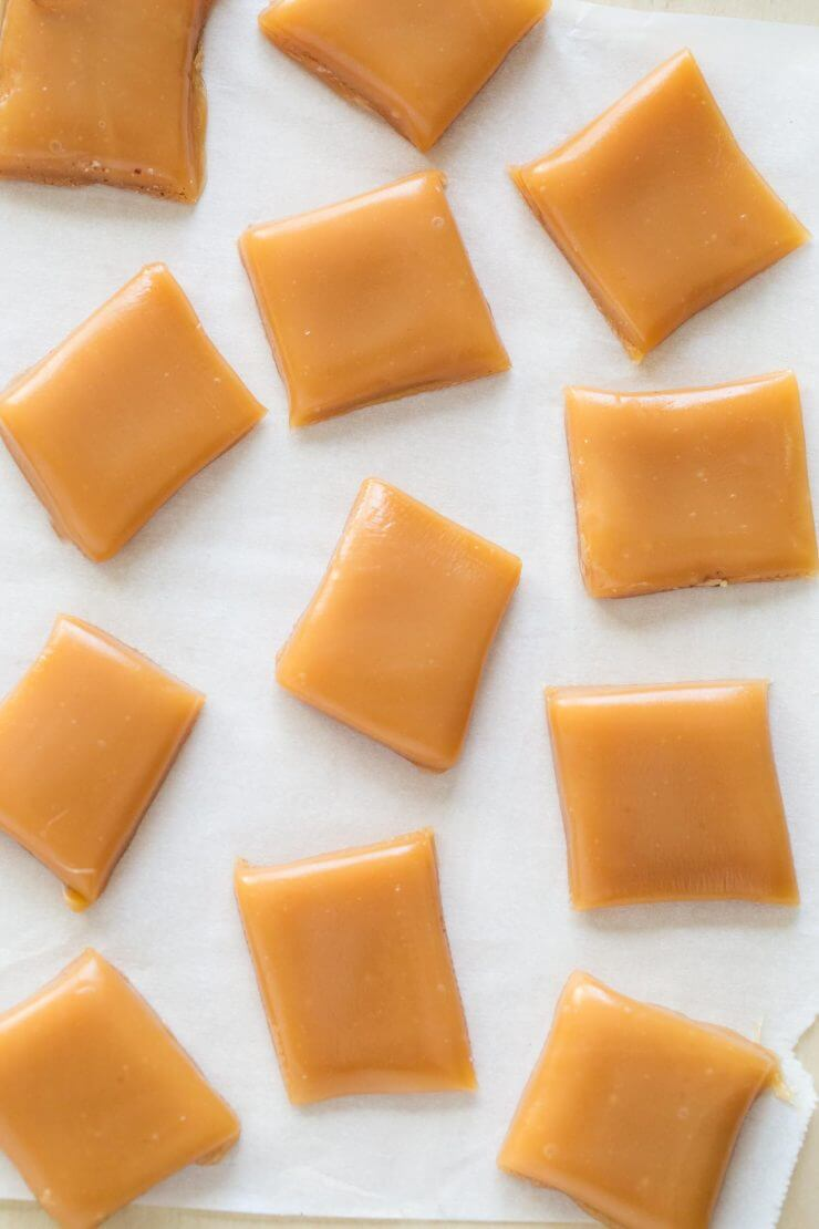 Cut caramel candy on wax paper