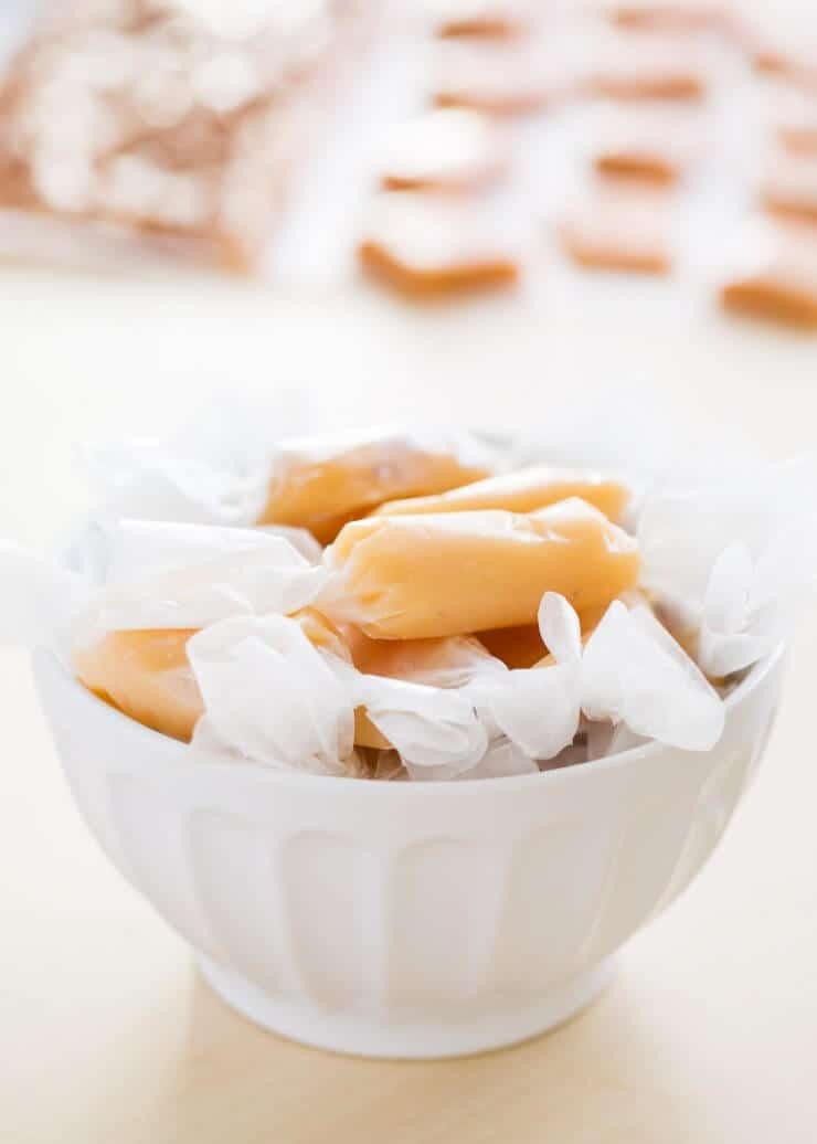 Caramel candies wrapped in a white bowl