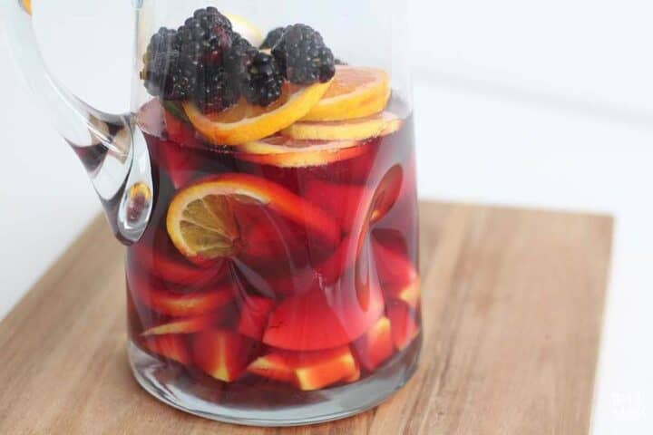 non-alcoholic sangria in a glass pitcher
