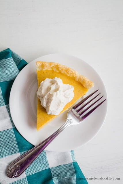 Holiday Eggnog Pie... a new, delicious favorite recipe to surprise family and friends! All the delicious flavors of drinking eggnog, but in a delectable pie version!