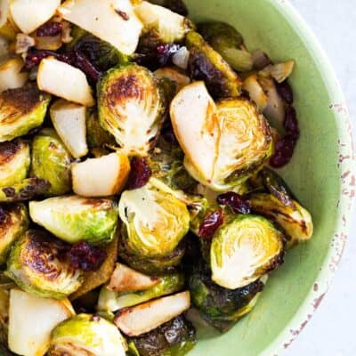 bowl of roasted brussels sprouts with cranberries and pears