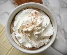 Snickerdoodle Hot Chocolate... a delicious twist on your standard hot chocolate, spiced with cinnamon sugar and perfect for the holiday season!