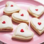 heart shaped empire cookies on a pink plate
