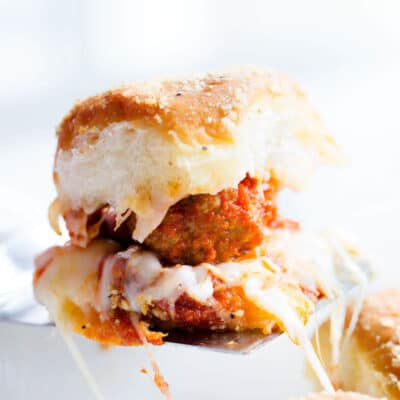 cheesy meatball slider on a spatula