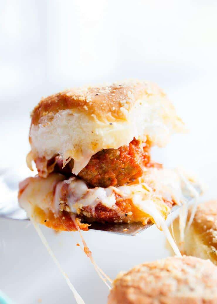 These delicious meatball sliders are the perfect EASY appetizer to make for your next party! They're made with Hawaiian rolls, meatballs, marinara, mozzarella and topped with a delicious butter and parmesan seasoning.