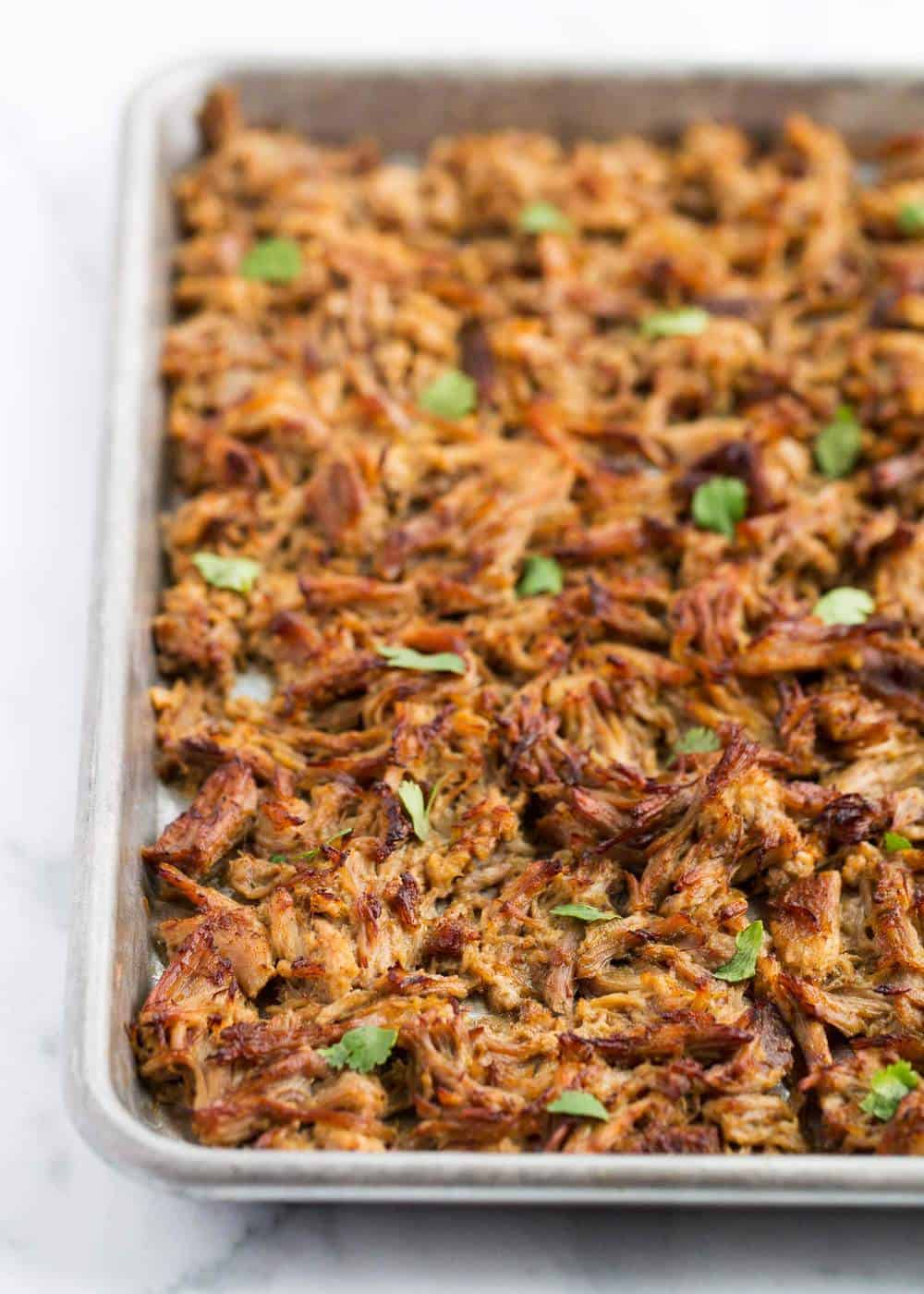 crispy carnitas on a baking sheet