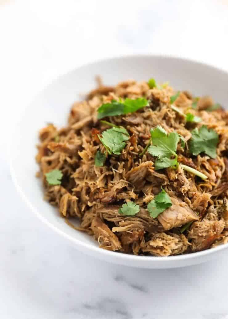 These Slow Cooker Carnitas are super easy to make and taste great in tacos, nachos, enchiladas or burritos! So tender and full of flavor!