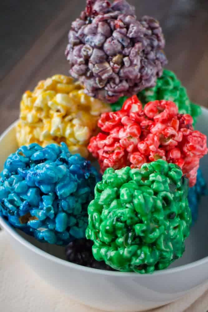 Rainbow popcorn balls + Top 50 Rainbow Desserts - the perfect way to celebrate St. Patrick's Day and welcome spring!