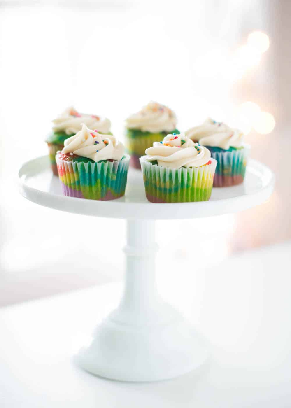 Rainbow cupcakes + 50 Rainbow Desserts - the perfect way to celebrate St. Patrick's Day and welcome spring!