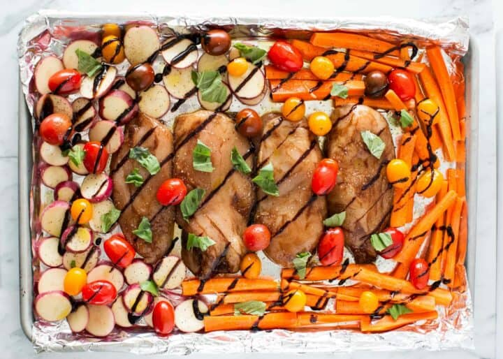balsamic chicken and vegetables on sheet pan lined with foil