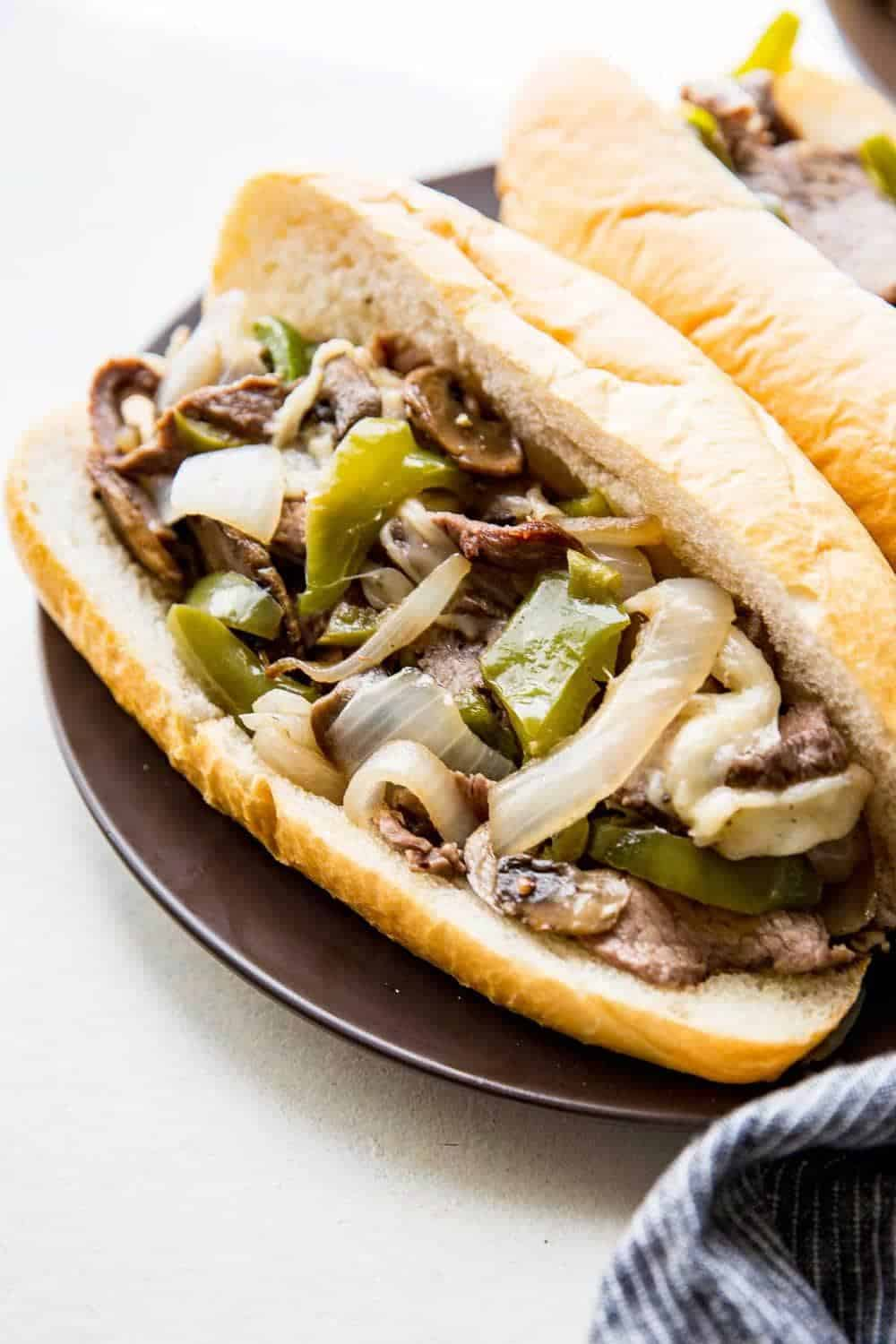 Philly cheesesteak + 25 Delicious Sheet Pan Dinner Recipes that will make dinnertime a dream with easy prep work and less dishes!