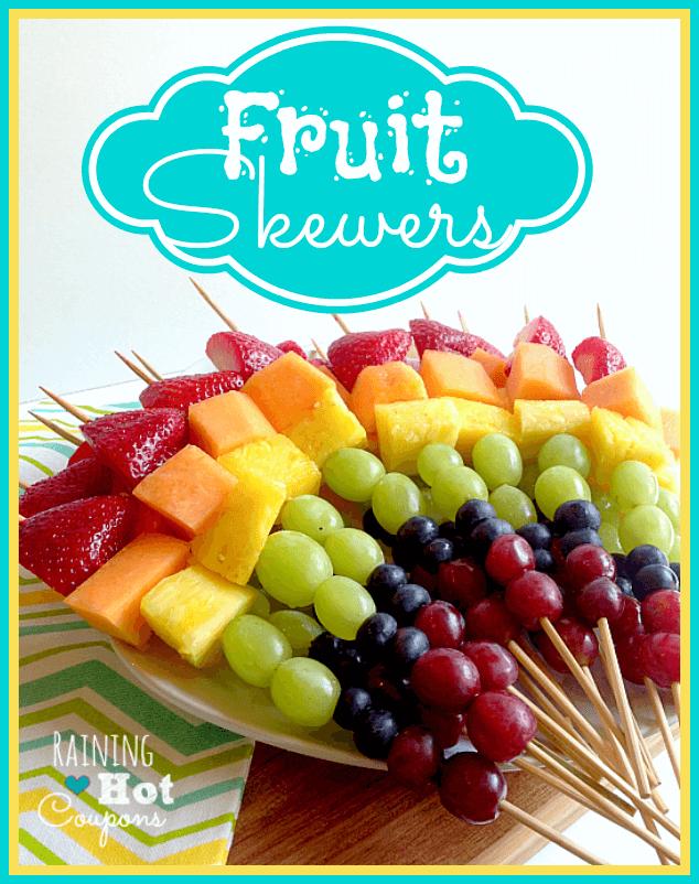 rainbow fruit skewers on a plate