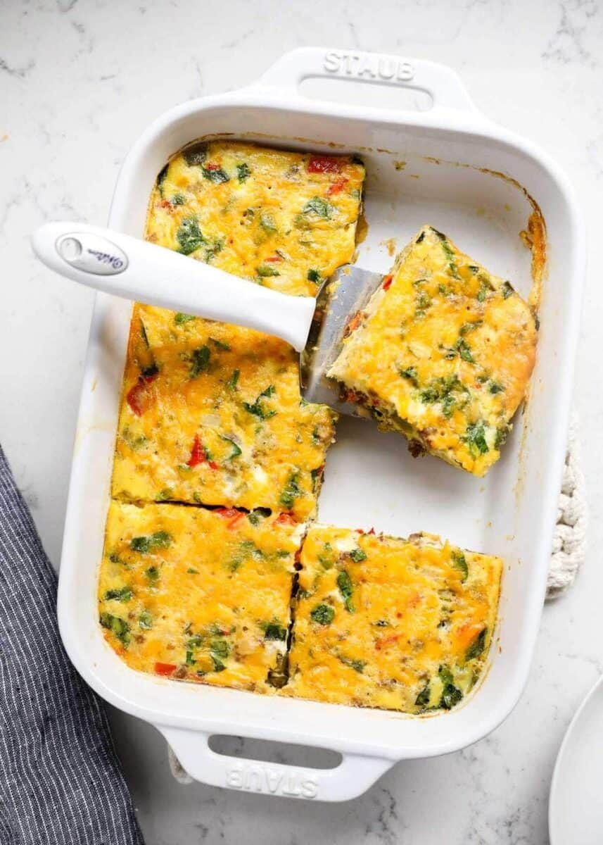 breakfast casserole cut into squares in pan
