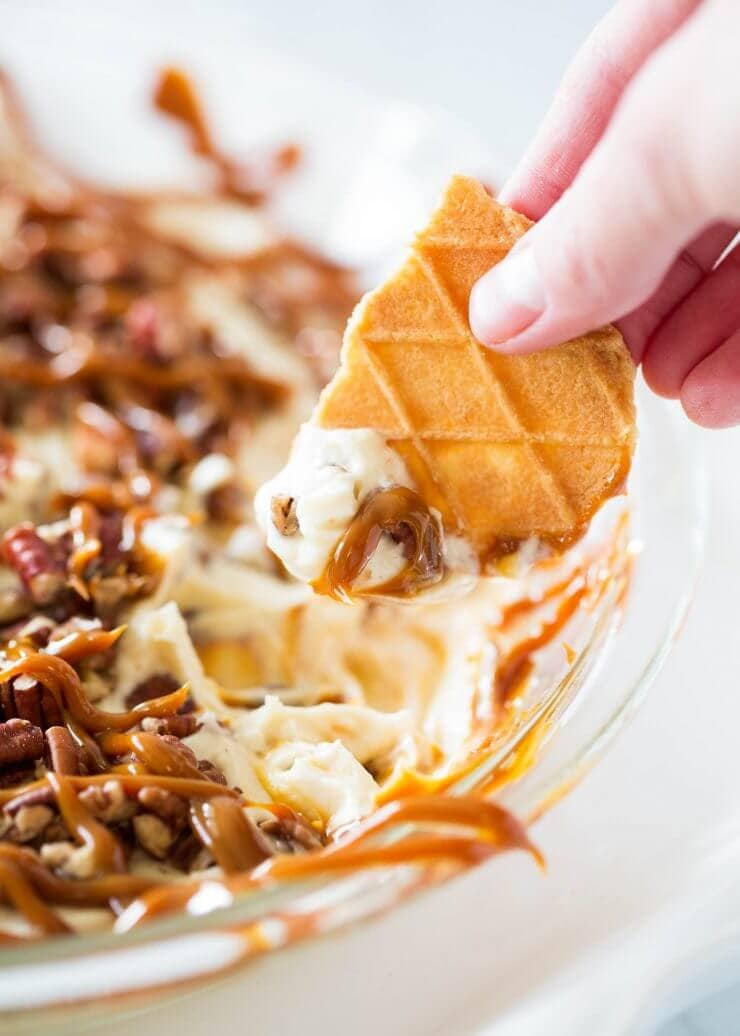 This cheesecake dip is super creamy, rich and completely addicting. It is the ultimate no-bake dessert and SO easy to make! Customize with your favorite mix-in's and dippers.