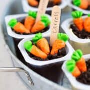 A close up of spring pudding cups with candy carrots