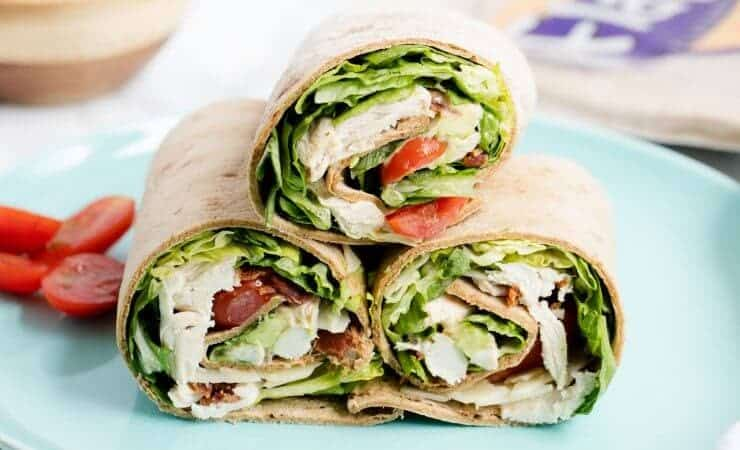 Chicken Caesar Wraps ...a quick, delicious lunch or appetizer that is light on calories! These Chicken Caesar Wraps feature crispy bacon, juicy tomatoes, avocado, lettuce and Caesar dressing.