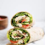 chicken caesar wrap cut in half and stacked on top of each other