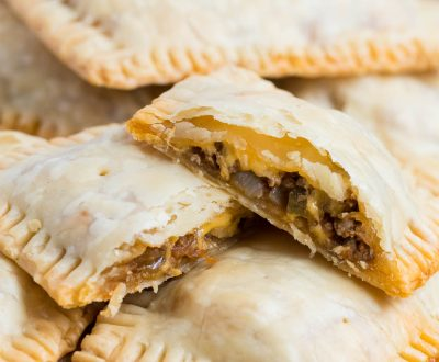 Taco Pop Tarts ...AKA mini taco pies are one of my families favorite! The flaky crust, seasoned taco meat, colby-jack cheese and fresh salsa give these such amazing flavor!