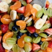 Rainbow Honey Lime Fruit Salad Recipe ...filled with fresh strawberries, oranges, bananas, grapes and blueberries. Topped with a honey lime glaze. This fruit salad is very easy and very tasty!