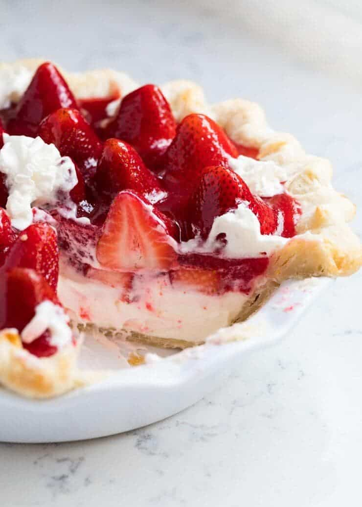 strawberry cream pie with a slice taken out