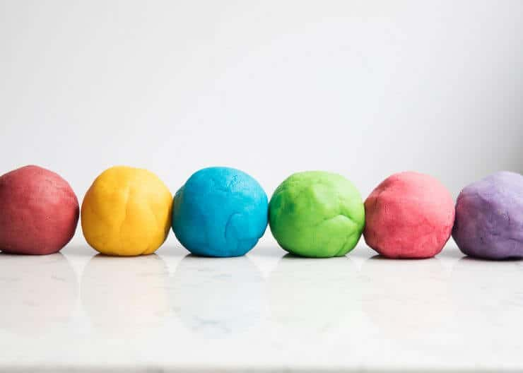 The BEST homemade play dough recipe - make in less than 5 minutes for under a $1 and have it last for months! It is so soft and squishy and cuts perfectly with cookie cutters.