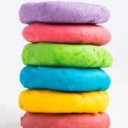 rainbow colored play dough stacked on top of each other