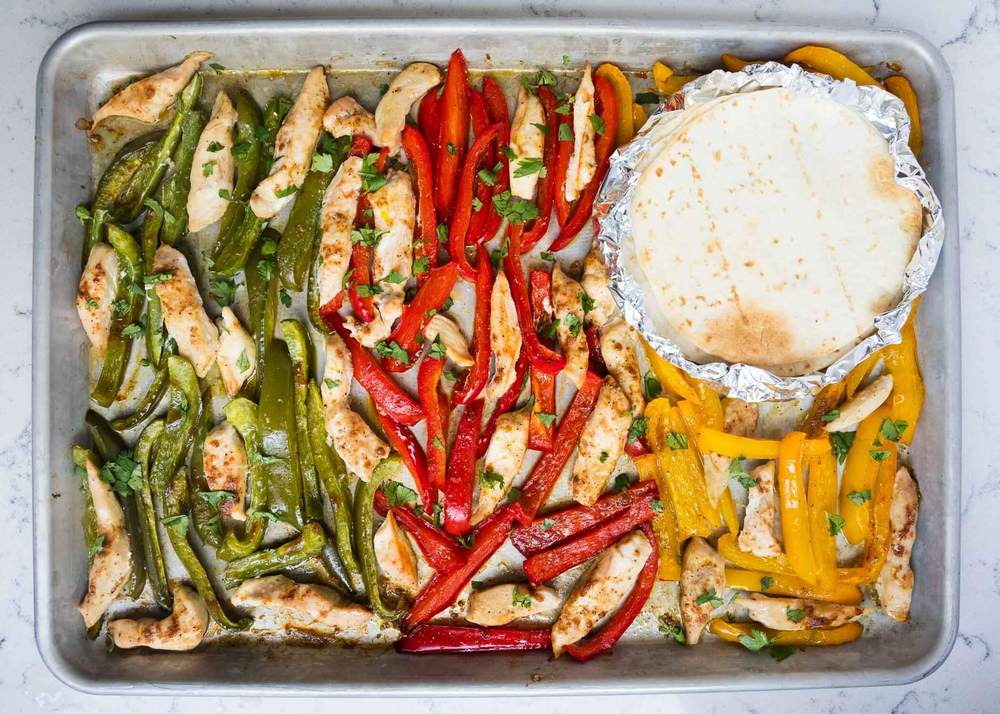 sheet pan fajitas on a baking sheet