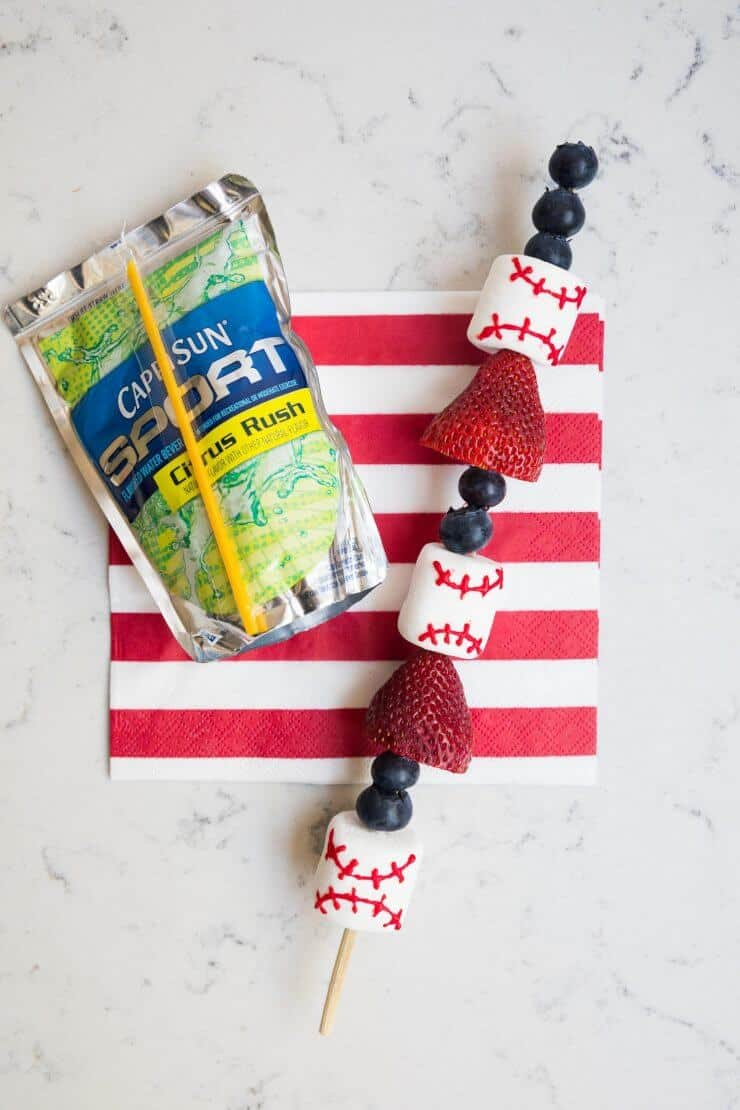 Baseball fruit skewers with marshmallows, strawberries and blueberries - a quick and tasty snack idea for kids games, parties and more!