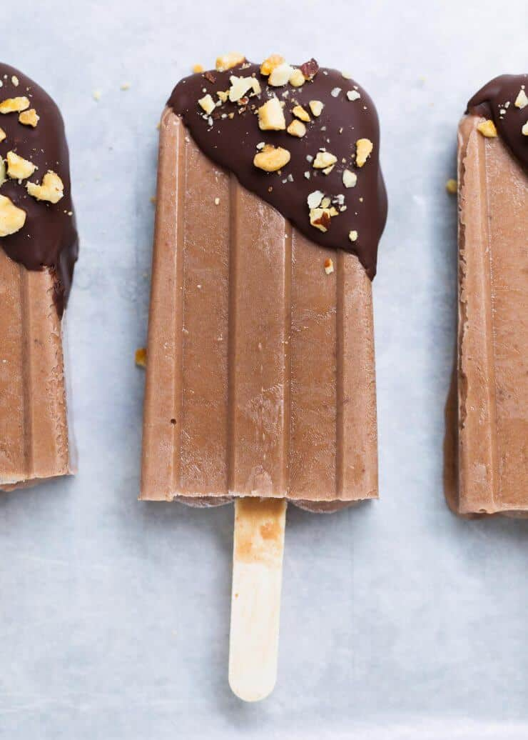 fudge popsicles dipped in chocolate and crushed nuts