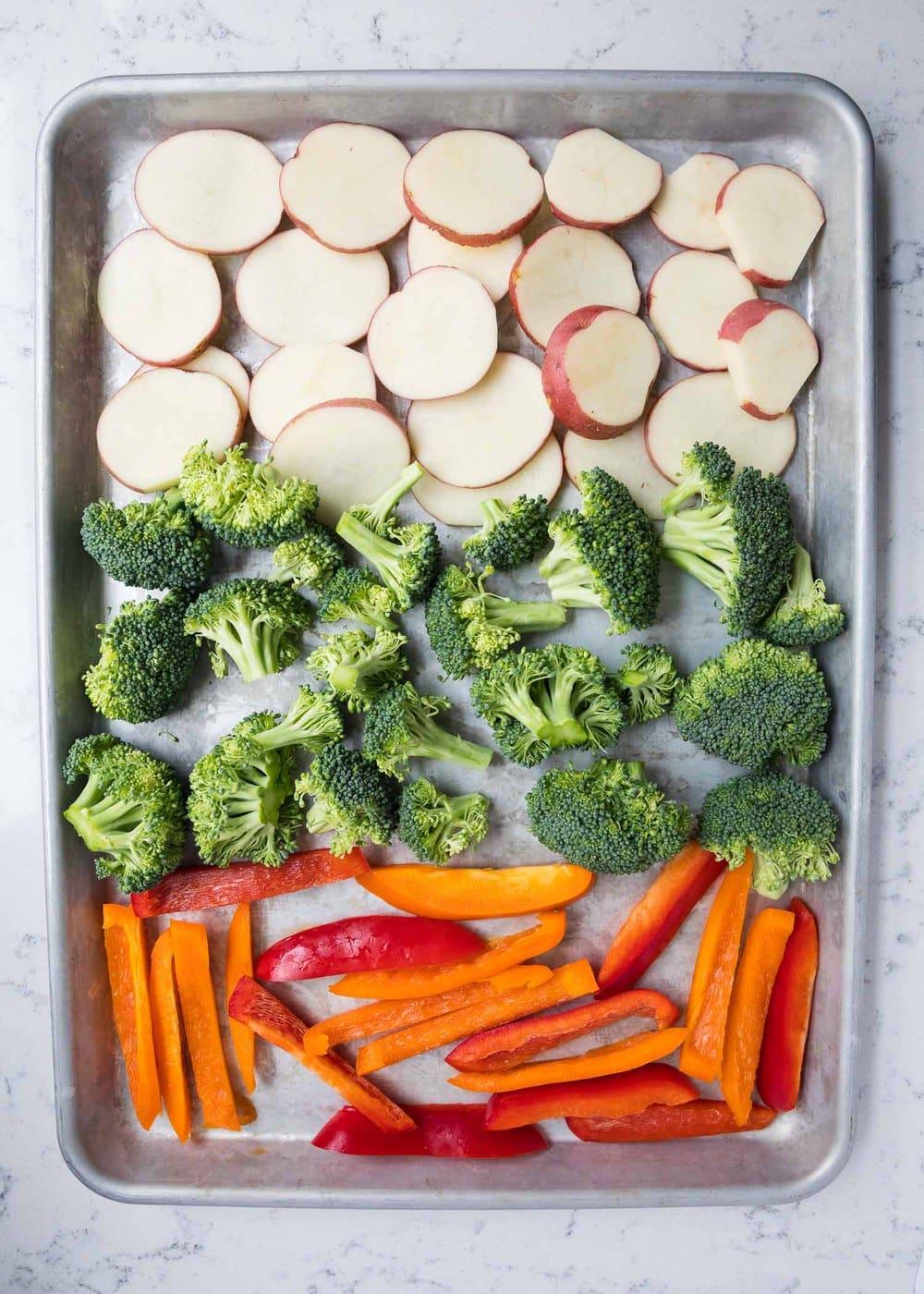 raw veggies on a baking sheet