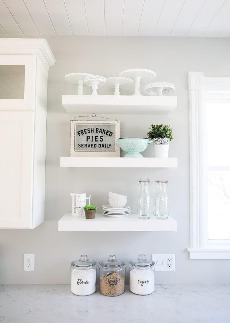 Modern farmhouse kitchen makeover with amazing before and after photos -white floating shelves